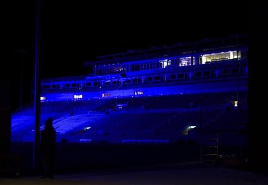 Dana J. Dykhouse Stadium glows blue early Saturday, Oct. 26, 2019 in Brookings, S.D.