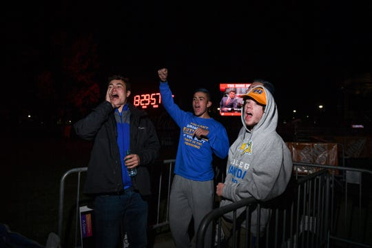 """The first South Dakota State University students in line for College GameDay lead those staying overnight in a chant of """"go big, go blue, go Jacks"""" around 8:00 p.m. on Friday, October 25, in Brookings. The group planned to chant every half hour to keep morale up through the long night."""