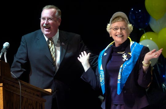 South Dakota State president Peggy Miller, right, and Mid-Continent Conference Commissioner Tom Douple share a laugh at the press conference to announce SDSU joining the conference in 2006.