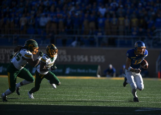 SDSU quarterback Kanin Nelson (12) runs the ball in the Dakota Marker game against NDSU on Saturday, Oct. 26, 2019 at Dana J. Dykhouse Stadium in Brookings, S.D.