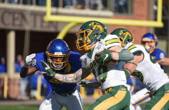 NDSU wide receiver Jimmy Kepouros (19) plows through SDSU defense in the Dakota Marker game on Saturday, Oct. 26, 2019 at Dana J. Dykhouse Stadium in Brookings, S.D.