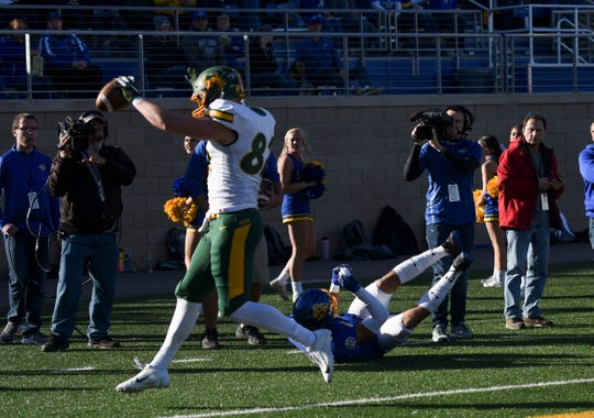 NDSU tight end Ben Ellefson (82) catches a touchdown pass in the Dakota Marker game against SDSU on Saturday, Oct. 26, 2019 at Dana J. Dykhouse Stadium in Brookings, S.D.