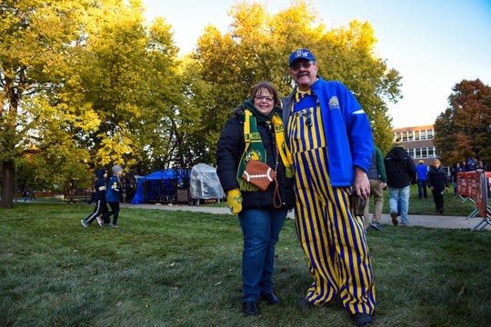 Jamie and Jerry King are a married couple with split allegiance. Each wears their own team's colors as they attend College GameDay on Saturday, October 26, in Brookings.
