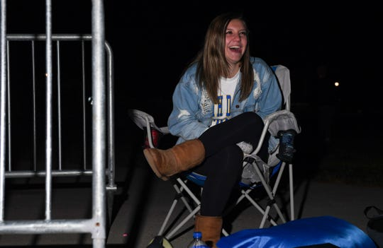 Hannah Kruse, a student at South Dakota State University, laughs while talking with a friend in line at the set of College GameDay on Friday, October 25, in Brookings.