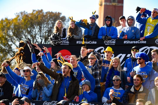 South Dakota State University fans boo as College GameDay's Lee Corso dons a Bison mascot head, signaling his pick for the day's game on Saturday, October 26, in Brookings.
