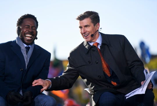 GameDay hosts Desmond Howard and Rece Davis joke around during the show on Saturday, Oct. 26, 2019 in Brookings, S.D.