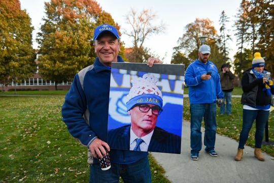 Rob Beyer poses with his sign for College GameDay at South Dakota State University on Saturday, October 26, in Brookings.