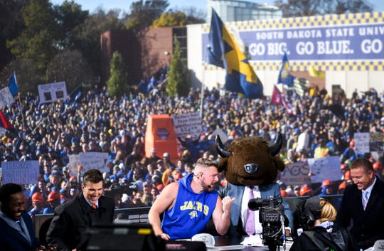 GameDay host Lee Corso puts on a bison head as his pick for the Dakota Marker game on Saturday, Oct. 26, 2019 in Brookings, S.D.