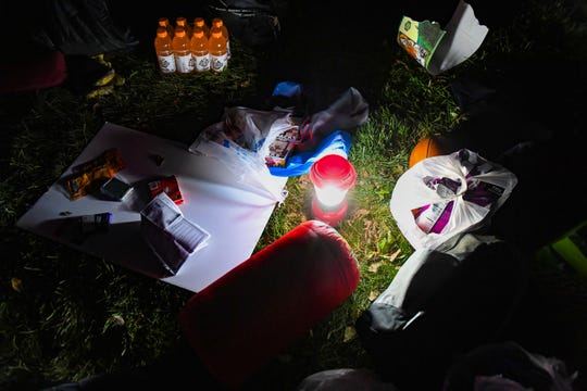 A lantern lights the supplies brought by a group of South Dakota State University students waiting overnight outside the set of College GameDay on Friday, October 25, in Brookings. Chips, cosmic brownies, gatorade, playing cards, a mini football and sleeping bags were included.