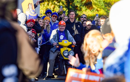 South Dakota State University coach John Stiegelmeier rides a small mo-ped into the College GameDay set on Saturday, October 26, in Brookings.