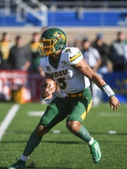 NDSU quarterback Trey Lance (5) runs the ball during the first half of the Dakota Marker game against SDSU on Saturday, Oct. 26, 2019 at Dana J. Dykhouse Stadium in Brookings, S.D.