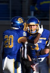 SDSU quarterback Keaton Heide (13) celebrates a touchdown in the Dakota Marker game against NDSU on Saturday, Oct. 26, 2019 at Dana J. Dykhouse Stadium in Brookings, S.D.