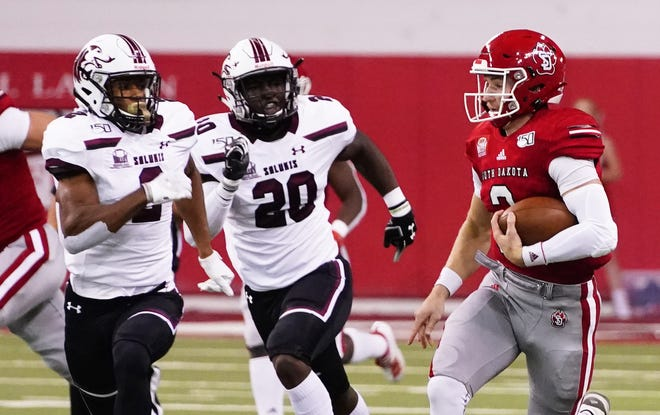 University of South Dakota quarterback Austin Simmons runs downfield as Southern Illinois defenders trail him on Oct. 26, 2019, at the DakotaDome in Brookings.