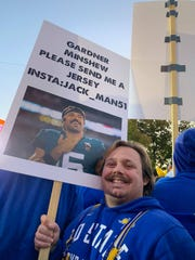 Jack Van Veldhuizen, a student at SDSU, holds a sign up at the College GameDay broadcast. He camped out at the College Green since 3:30 a.m., he said.