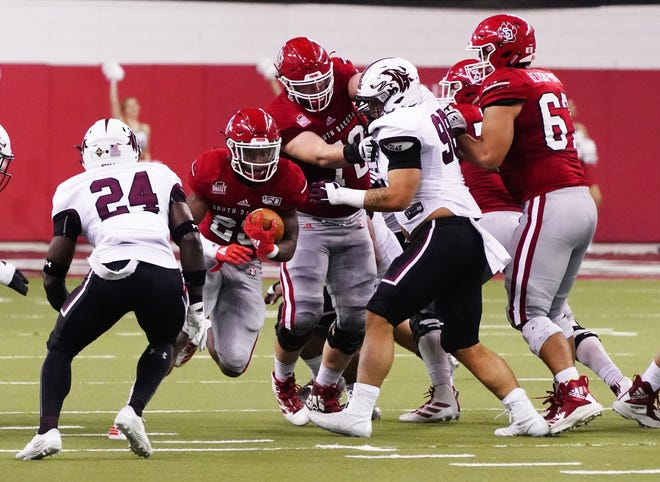 University of South Dakota running back Canaan Brooks looks for a hole against Southern Illinois on Oct. 26, 2019, at the DakotaDome in Vermillion.