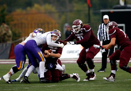 Missouri State Bears quarterback Peyton Huslig is sacked by University of Northern Iowa defenders during a game at Plaster Stadium on Saturday, Oct. 26, 2019.