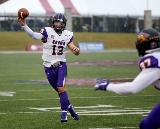 University of Northern Iowa quarterback Will McElvain makes a pass to receiver Aaron Graham during a game against the Missouri State Bears at Plaster Stadium on Saturday, Oct. 26, 2019.
