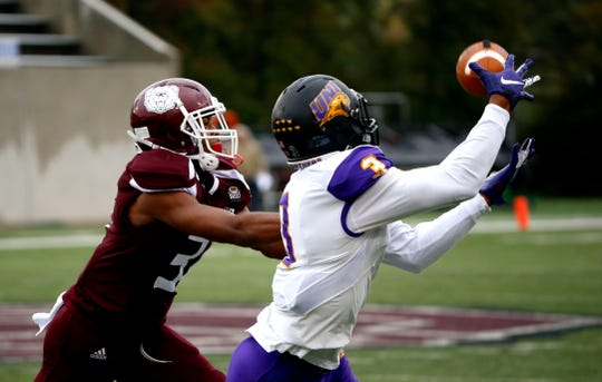 University of Northern Iowa receiver Suni Lane makes a catch as Missouri State's Jaylen Henderson attempts to break up the pass during a game at Plaster Stadium on Saturday, Oct. 26, 2019.