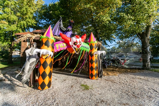 "A spooky clown ""fun house"" portal transforms the carport into something else entirely. A dragon keeps watch from atop the carport."