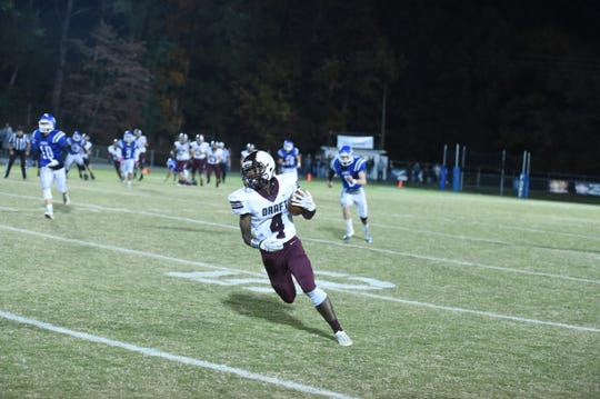 Stuarts Draft's Jo'-el Howard takes off for an early touchdown reception Friday night against Fort Defiance.