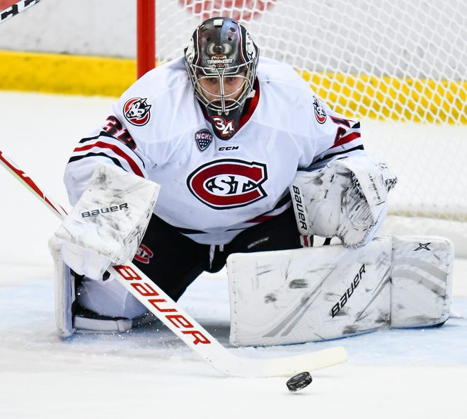 St. Cloud State goaltender David Hrenak concentrates on the puck during the first period of the Friday, Oct. 25, 2019, game at the Herb Brooks National Hockey Center in St. Cloud.