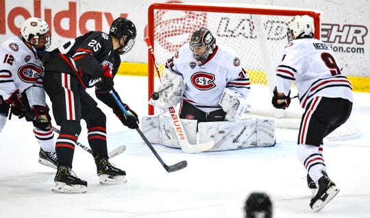 St. Cloud State goaltender David Hrenak makes a save during the first period of the Friday, Oct. 25, 2019, game at the Herb Brooks National Hockey Center in St. Cloud.