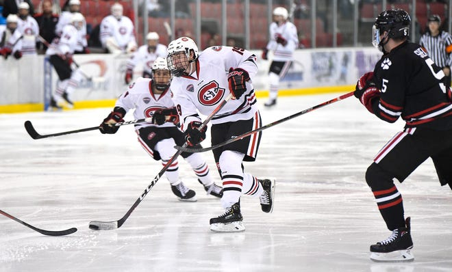 St. Cloud State's Sam Hentges skates with the puck during the first period of the Friday, Oct. 25, 2019, game at the Herb Brooks National Hockey Center in St. Cloud.