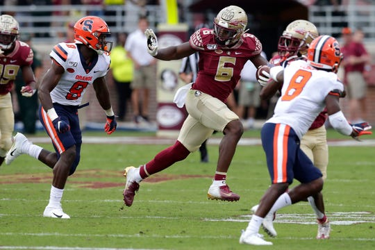 Florida State Seminoles tight end Tre' McKitty (6) fights off defenders. The Florida State Seminoles host the Syracuse Orange for the 2019 homecoming game Saturday, Oct. 26, 2019.