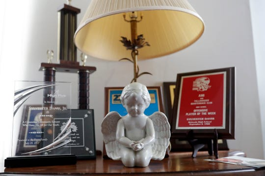 Helen Gainous displays her son's trophies and awards in her home. Gainous's son Sylvester Davis Jr. was shot and killed in his home 14 years ago.