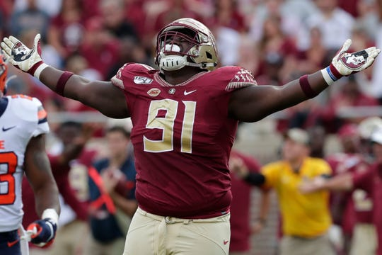 Florida State Seminoles defensive tackle Robert Cooper (91) celebrates a tackle. The Florida State Seminoles host the Syracuse Orange for the 2019 homecoming game Saturday, Oct. 26, 2019.