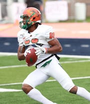 FAMU wide receiver Marcus Williams runs through pregame drills in prep for Morgan State.