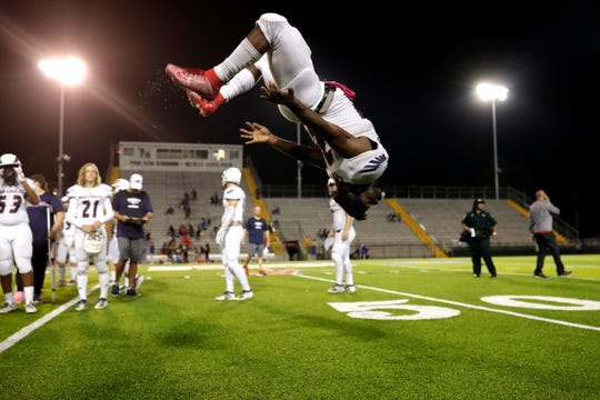A Wakulla player celebrates the team's victory with a backflip. Wakulla shutout Rickards Friday, Oct. 25, 2019. The War Eagles finished their regular season games with a record of 10-0.