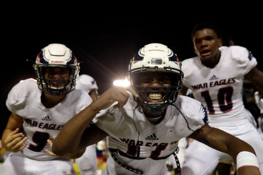 Wakulla senior Keyshawn Greene and his teammates celebrate their victory as the War Eagles shut out Rickards Friday, Oct. 25, 2019. The War Eagles finished their regular season games with a record of 10-0.