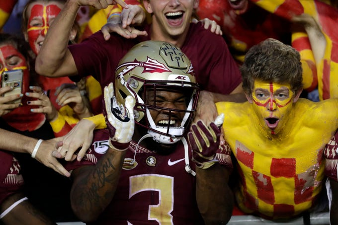Florida State Seminoles running back Cam Akers (3) celebrates a Seminole victory with fans after beating the Syracuse Orange.