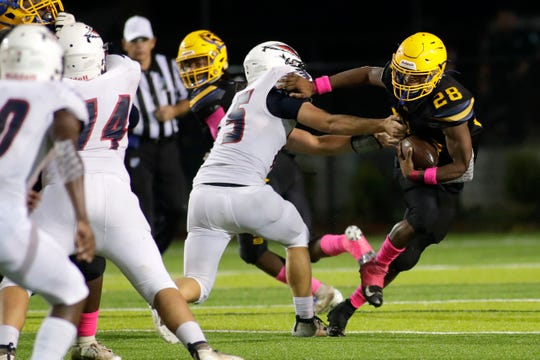 Rickards Raiders running back Devin Bailey (28) pushes off a defender in a game versus Wakulla on Friday, Oct. 25, 2019. The War Eagles finished their regular season games with a record of 10-0.
