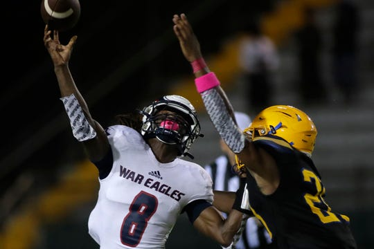 Wakulla War Eagles quarterback Jaylon Worsham (8) throws the ball to an open player. Wakulla shutout Rickards Friday, Oct. 25, 2019. The War Eagles finished their regular season games with a record of 10-0.
