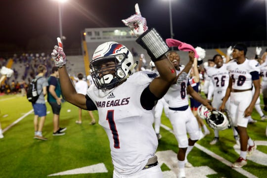 Wakulla War Eagles running back Jakari Ervin (1) celebrates his team's victory. Wakulla shutout Rickards Friday, Oct. 25, 2019. The War Eagles finished their regular season games with a record of 10-0.
