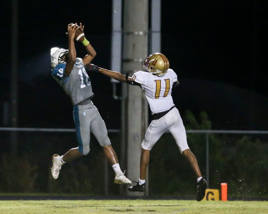 Jensen Beach's DaQuan Gonzales (18) hauls in a pass for a touchdown against Coconut Creek during the second quarter in District 14-5A championship high school football game at Jensen Beach High School on Friday, Oct. 25, 2019, in Jensen Beach.