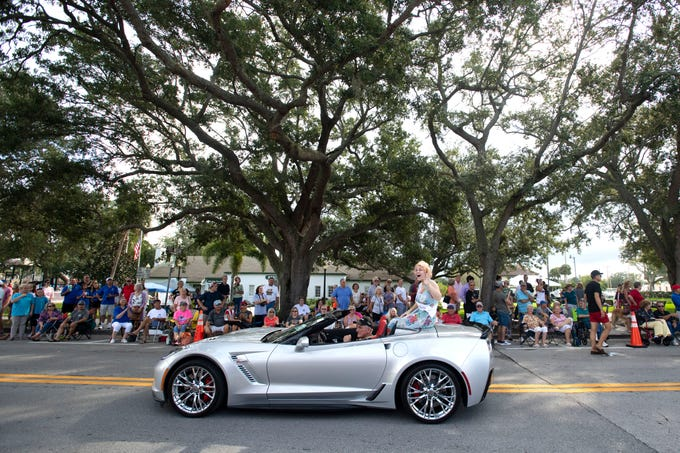 "The 2019 Miss Hibiscus, Rebekah Parsons, rolls down 14th Avenue during the Vero Beach Centennial Finale parade Saturday, Oct. 26, 2019, in downtown Vero Beach. The parade was filled with local dignitaries, including 90-year-old resident and former commissioner Alma Lee Loy, who is known as the ""First Lady of Vero Beach"" and who served as the parade's Grand Marshal."