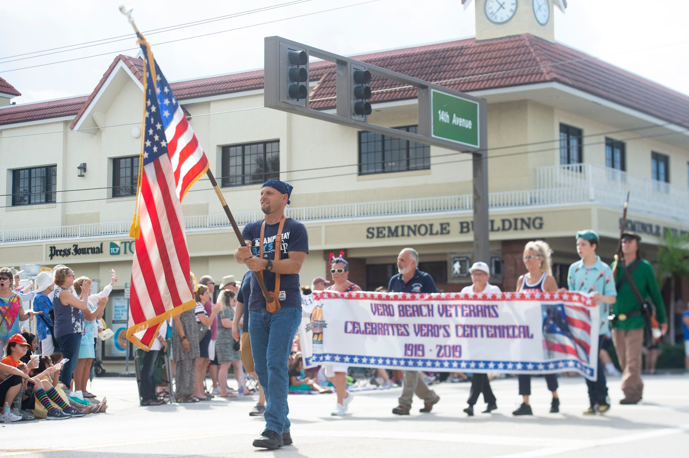 The Vero Beach Centennial Finale parade rolls down 14th Avenue on Saturday, Oct. 26, 2019, in downtown Vero Beach. About 100 businesses, schools, organizations, law enforcement agencies, churches and more marched from Vero Beach High School through downtown in celebration of Vero Beach's 100th birthday. The day-long event was cut short because of rain showers.