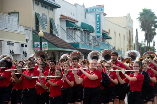 The Vero Beach High School Fighting Indians Band marches down 14th Avenue during the Vero Beach Centennial Finale parade Saturday, Oct. 26, 2019, in downtown Vero Beach. About 100 businesses, schools, organizations, law enforcement agencies, churches and more marched from Vero Beach High School through downtown in celebration of Vero Beach's 100th birthday. The day-long event was cut short because of rain showers.