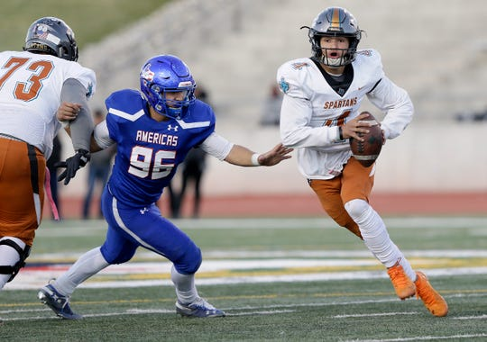 Pebble Hills quarterback Sebastian Ochoa runs past Americas' Dylan Kemp on a keeper Friday at the SAC.