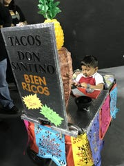 Santino Montero, 2, seemed to be taking orders on his mom's phone, dressed up like a tacos al pastor stand, at Spooktacular on Saturday, Oct. 26, 2019, at the El Paso County Coliseum.