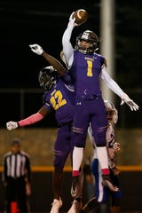 Burges' Alec Marenco (1) and Tavorus Jones (22) celebrate Marenco's touchdown during the game against Bowie Friday, Oct. 25, at Burger High School in El Paso.