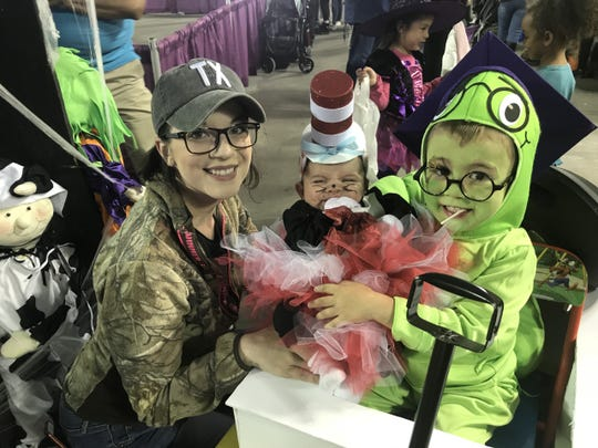 Andrea Fournier with Hayden, 2 months, and Weston, 2, had fun dressing up for Spooktacular on Saturday, Oct. 26, 2019, at the El Paso County Coliseum.
