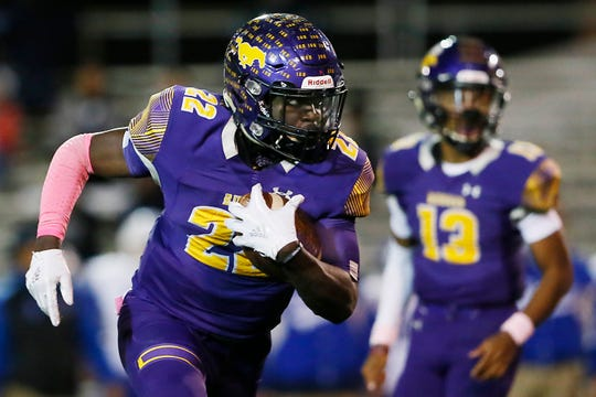 Burges' Tavorus Jones (22) runs the ball during the game against Bowie on Friday, Oct. 25, 2020, at Burger High School in El Paso.