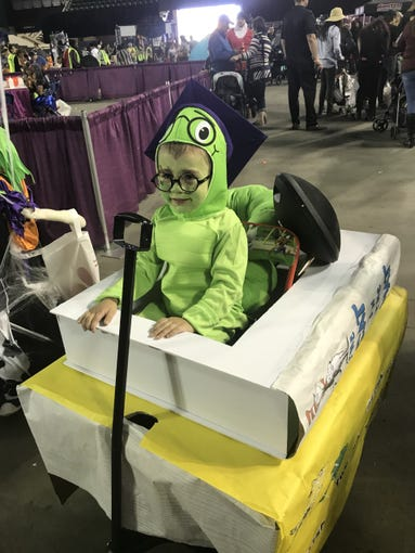 Weston Fournier, 2, was dressed up as a book worm complete with Dr. Seuss books Saturday at Spooktacular. His mom planned to put him in the costume contest.
