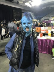 "Monica Alvarez hams it up as Maurice from ""Little Monsters"" at Spooktacular on Saturday, Oct. 26, 2019, at the El Paso County Coliseum."