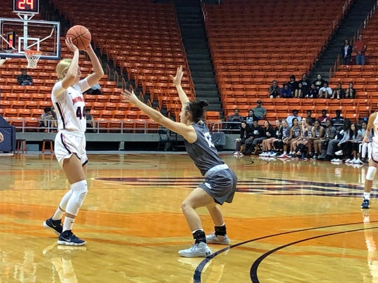 UTEP's Katarina Zec looks for a passing lane against the defense of Eastern New Mexico's Zamorye Cox Saturday