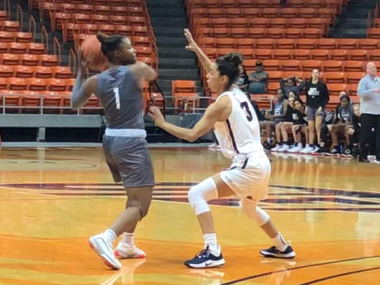 UTEP's Katia Gallegos (right) guards Eastern New Mexico's Anasha Hurst during Saturday's exhibition at the Don Haskins Center